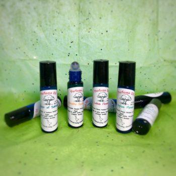 Four perfume oils in 10 mL blue glass roller ball bottles